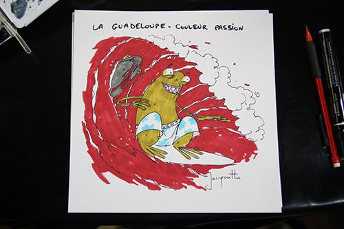 Le crapaud - Nicolas Jacquette - festival du dessin de presse de Saint-Just-Le-Martel octobre 2012 - Guadeloupe, des requins massacrés pour le surf